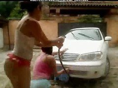 Two Busty Latina Girls Washing Car