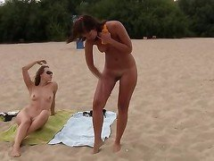 This teen nudist strips bare at a public beac