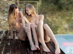 Two beautiful babes playing with each other