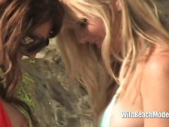 Hot lesbians get wet and sandy