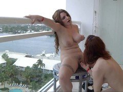 Lesbian play on the balcony