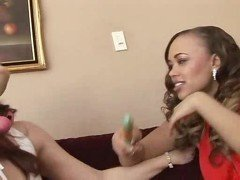 Hot lesbians go at it with a strap on