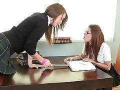 Three perfect lesbians are licking pussies in the office