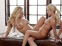 Two lusty blondes scissoring and making out next to a window